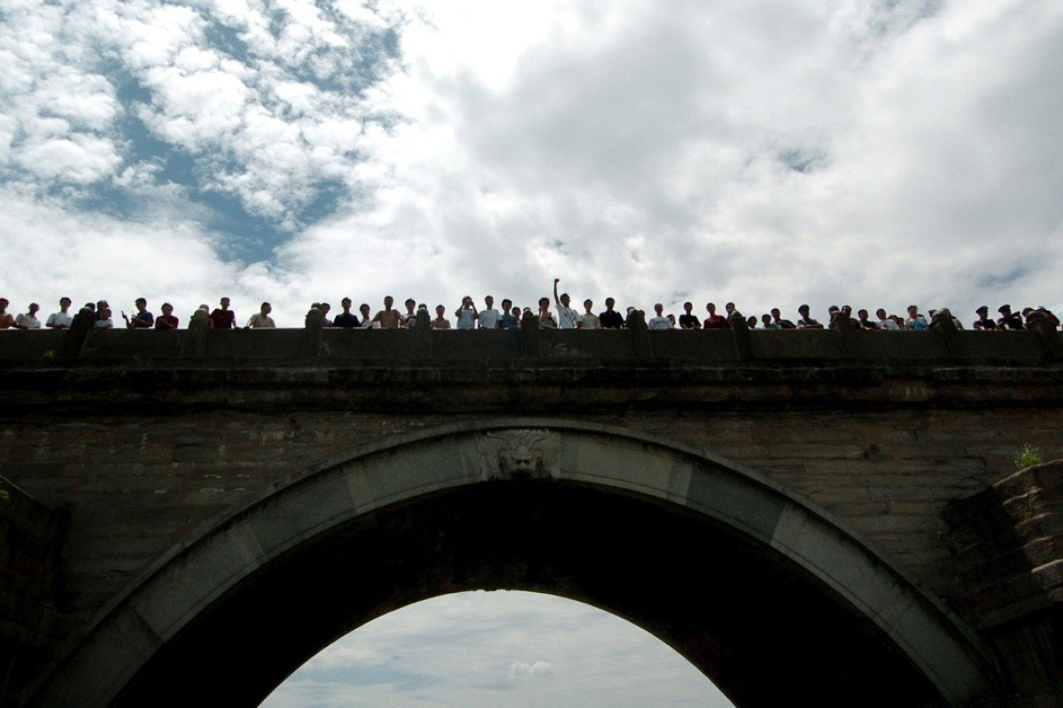 Chinese demonstrators at the Marco Polo Bridge mark an anniversary of the 1937 clash with Japanese troops. Photo: Reuters