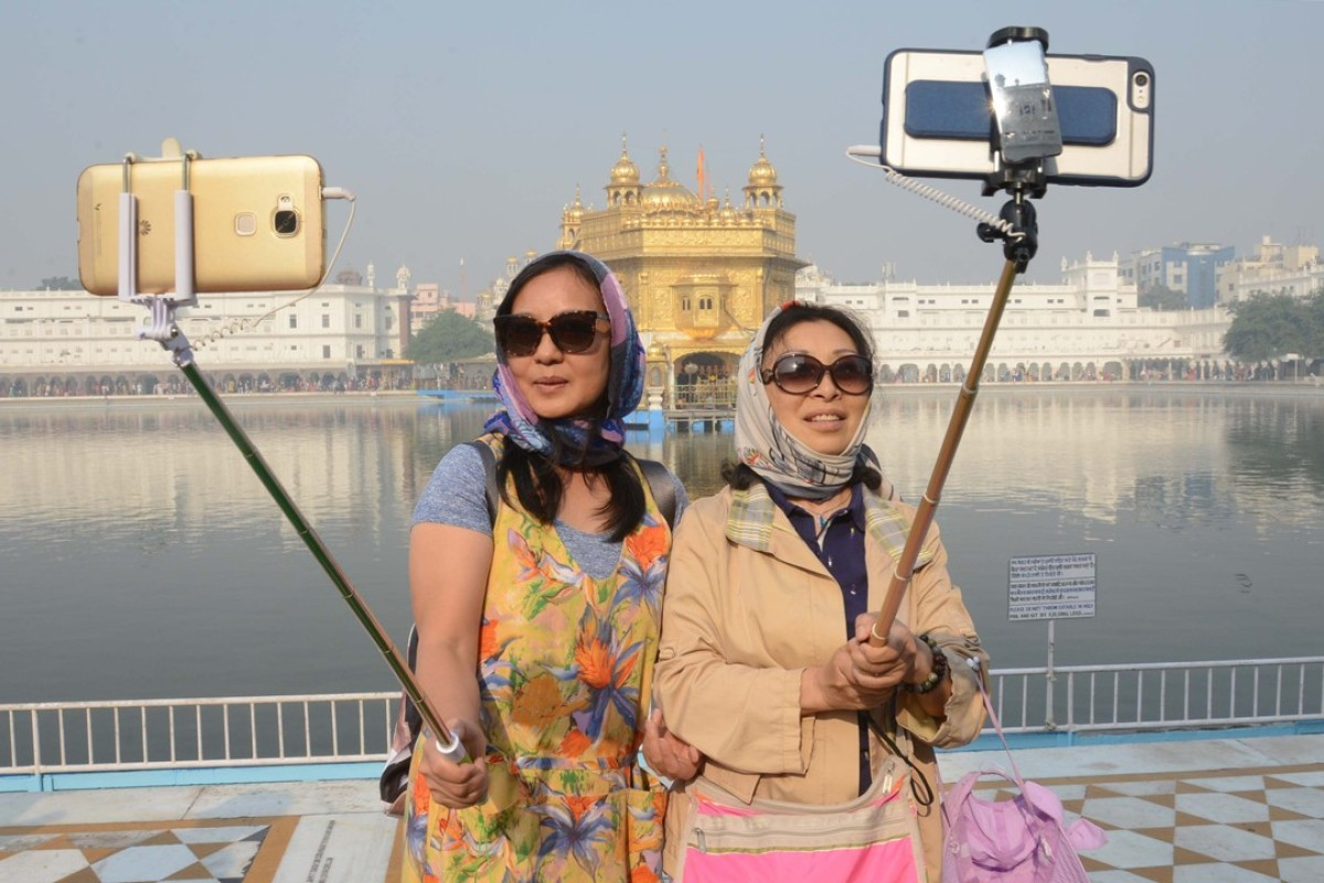 Chinese tourists at the Golden Temple in Amritsar, India. Picture: AFP