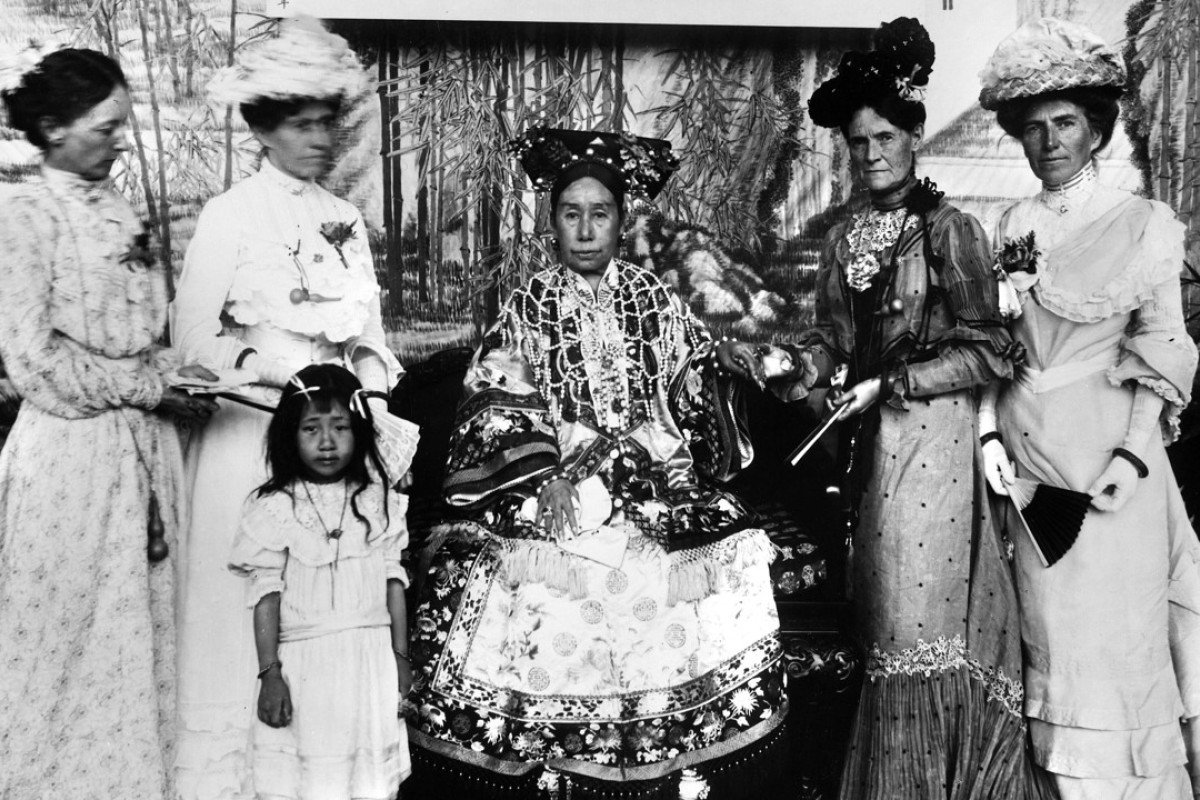 Maurice Collis dramatised the life of China's Empress Dowager Cixi, pictured above with the wives of foreign diplomats and their adopted orphan. Picture: Alamy