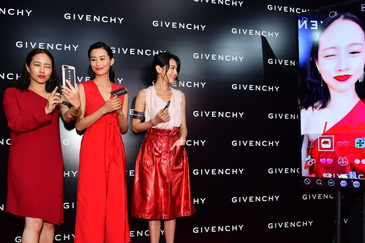 Karena Lam, Fala Chen and Chrissie Chau trying out Givenchy's beauty app.