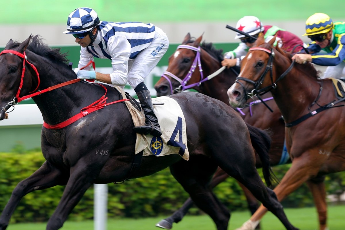 Joao Moreira guides Seasons Bloom to victory in the HKSAR Chief Executive's Cup at Sha Tin on Sunday. Photos: Kenneth chan