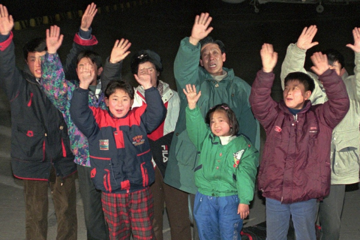 North Korean defectors wave after arriving in South Korea by boat in January 1997. Picture AP