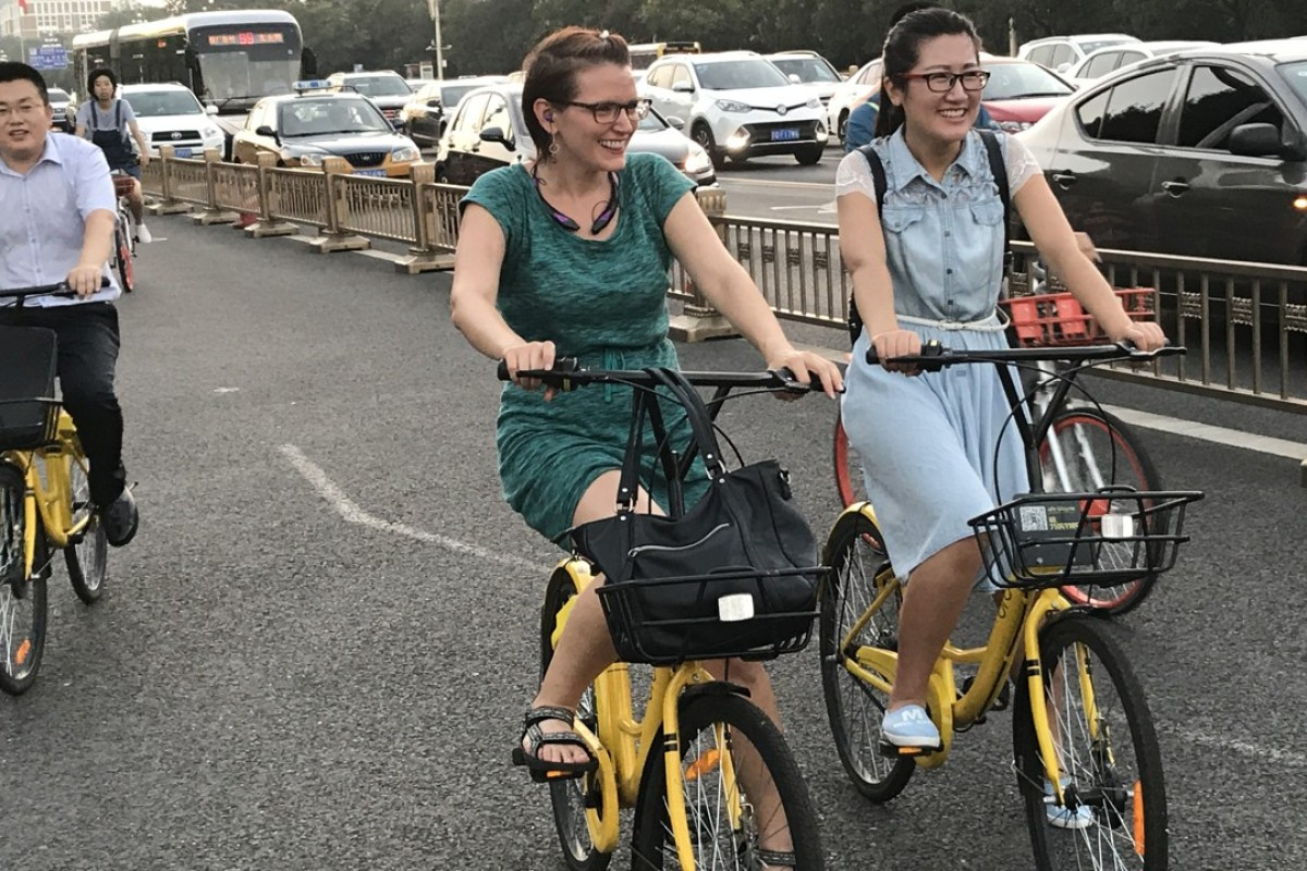 People ride shared bicycles on Chang'an Avenue in Beijing. Photo: Xinhua