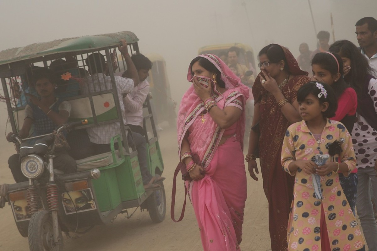 Indians cover their faces amid thick fog in the capital New Delhi. The Supreme Court has banned the use of firecrackers during the Hindu festival of Diwali because of pollution concerns. Photo: EPA