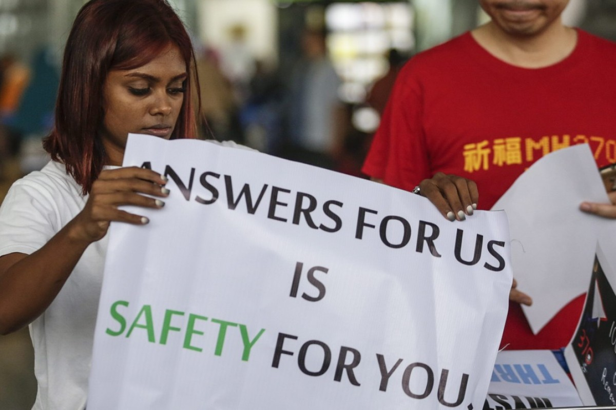 Relatives of the passengers aboard missing flight MH370 at Kuala Lumpur International Airport. Photo: EPA