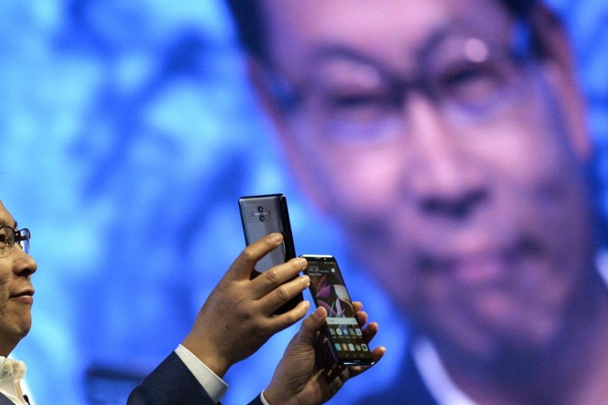 Richard Yu, chief executive of Huawei's consumer business group, presents the new Huawei Mate 10 and Mate 10 Pro phones at the official launch event in Munich, southern Germany, on Monday. Photo: EPA