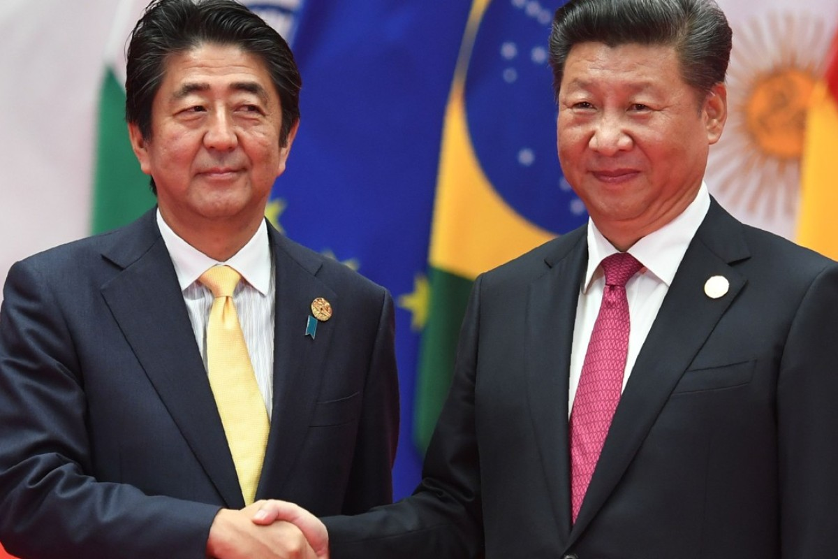 Japanese Prime Minister Shinzo Abe shakes hands with China's President Xi Jinping. Photo: AFP