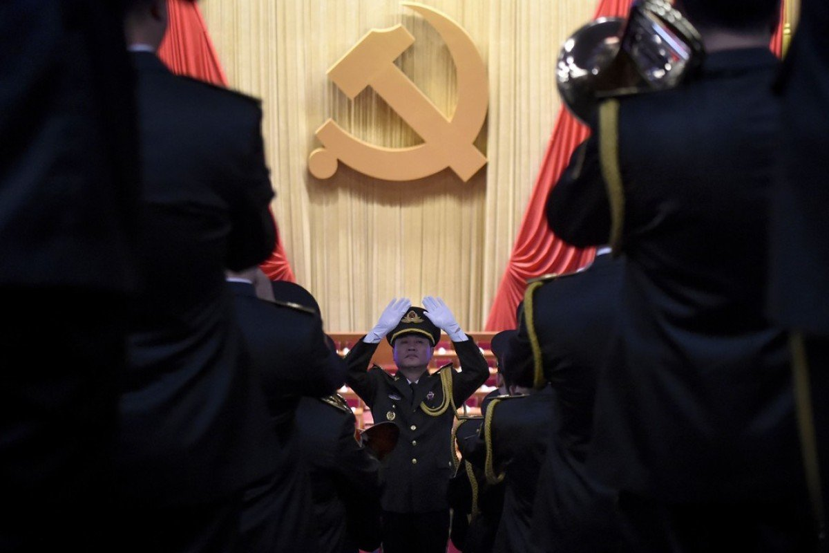 A Chinese People's Liberation Army officer conducts a military band before the opening of the Communist Party's five-yearly congress in Beijing. Photo: AFP