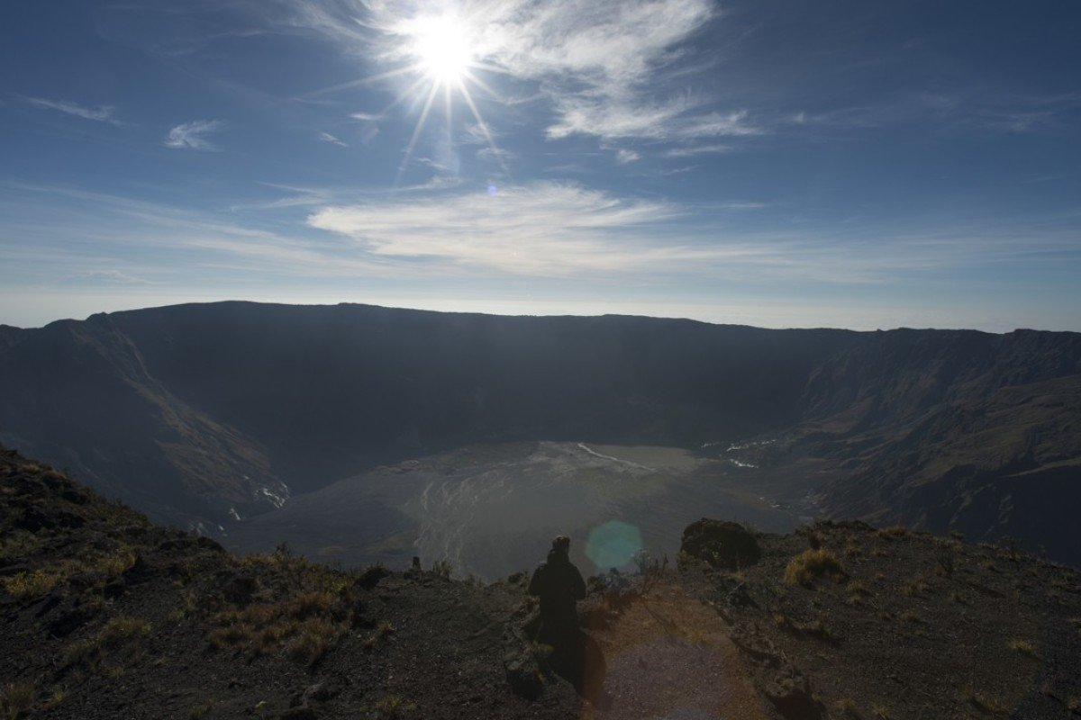 Peter Day sits at the crater's edge, on Mount Tambora, on the Indonesian island of Sumbawa. Pictures: Antony Dickson