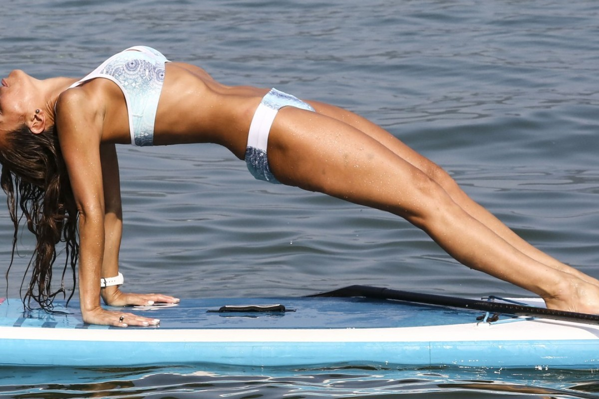 Stand-up paddle board yoga teacher Charlotte Piho has been dubbed The Real Moana because she feels at home on the water. Photo: Jonathan Wong