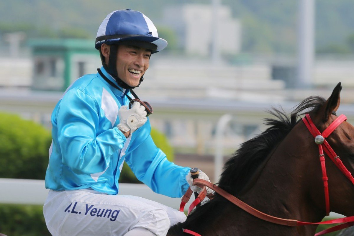 Keith Yeung is all smiles after winning with Winner St Paul's on Sunday. Photos: Kenneth Chan