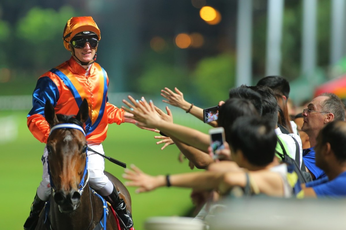 Zac Purton celebrates with fans after another Happy Valley win. Photos: Kenneth Chan.