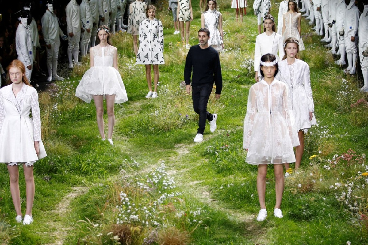 Italian designer Giambattista Valli (centre) appears with models in Paris at his spring/summer 2016 women's ready-to-wear collection for Moncler Gamme Rouge. Photo: Reuters