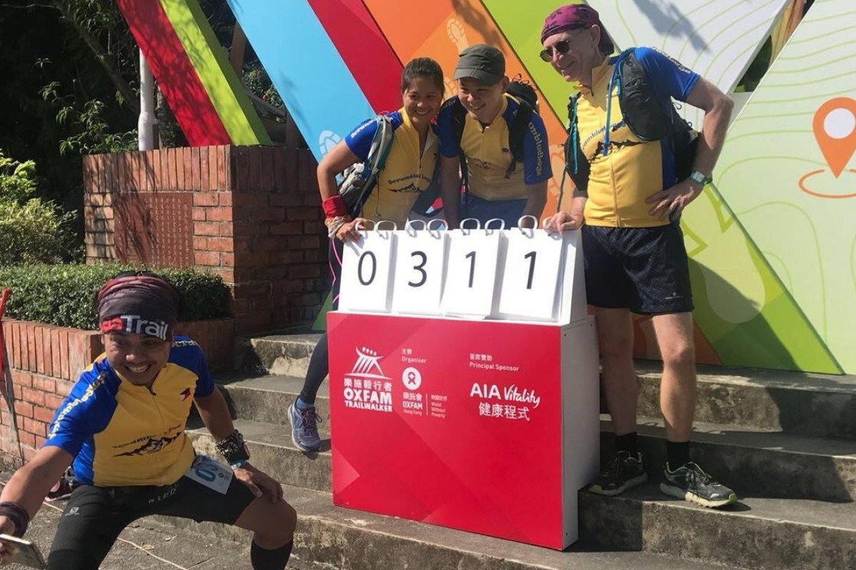 Rowell Campos takes a selfie with Scrambled Legs teammates Daisy Linas, Amos Koh and Ray Walkden before the start of the Oxfam Trailwalker. Photos: Andrew McNicol