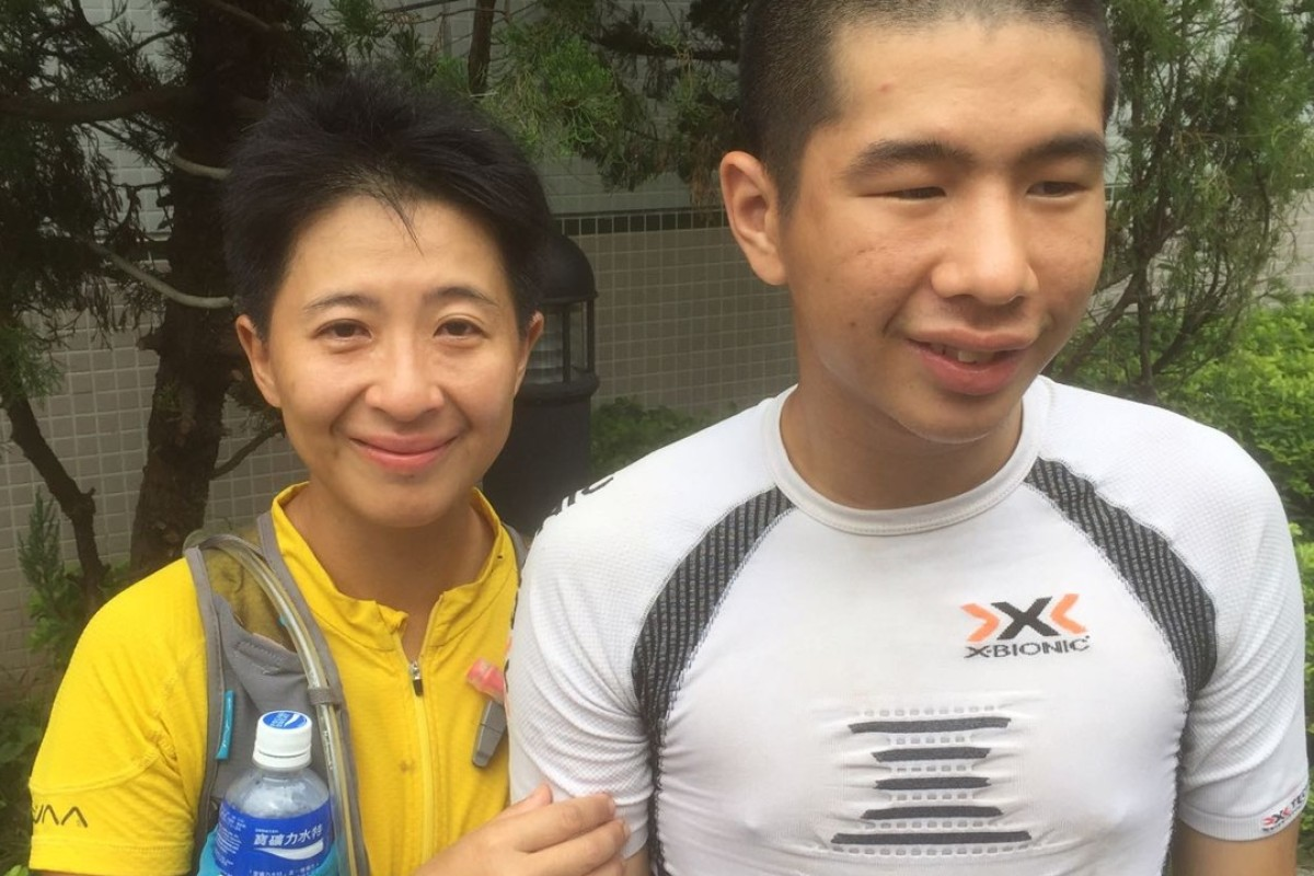 Celvin Tsang and his mother Lee Wing Suen on the finish line of Trailwalker. Photos: Mark Agnew