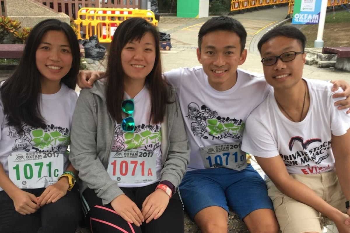 (L-R) Michelle Tam, Kelly Lau, Galleo Cheung and Isaac Wong of the Four In Love team smile for cameras at the finish of the Oxfam Trailwalker. Photo: Ben Young