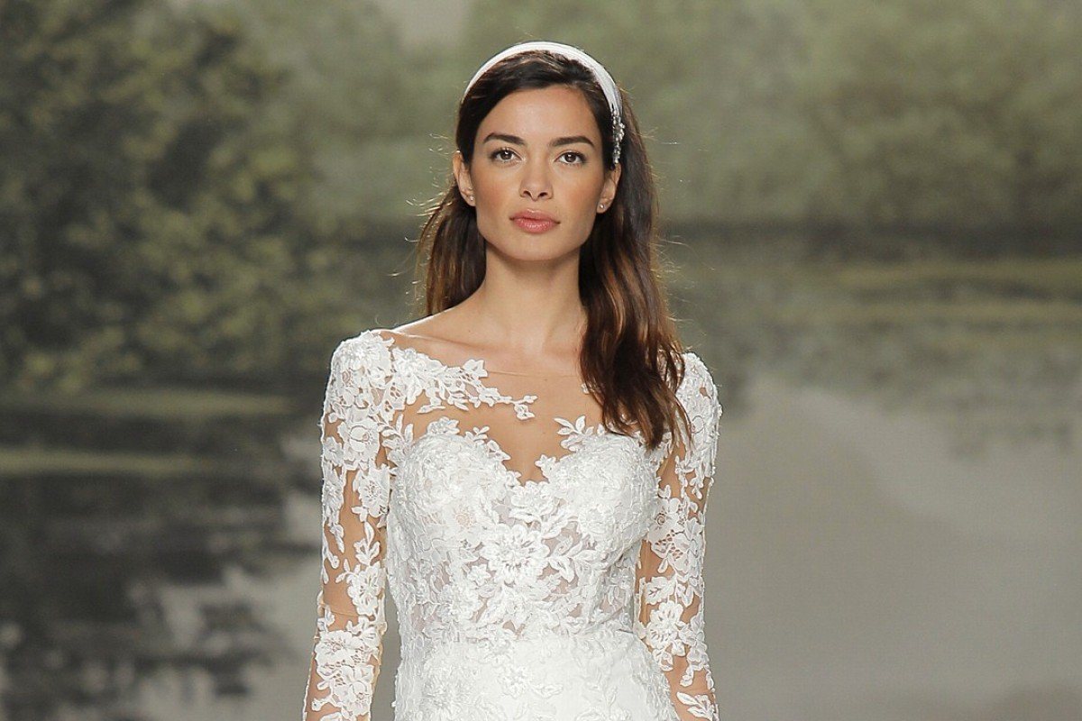 Modesty makes a comeback in bridal fashion as wedding gowns trend studio st patrick uses lace in its long sleeved wedding gowns available at hitched junglespirit Choice Image