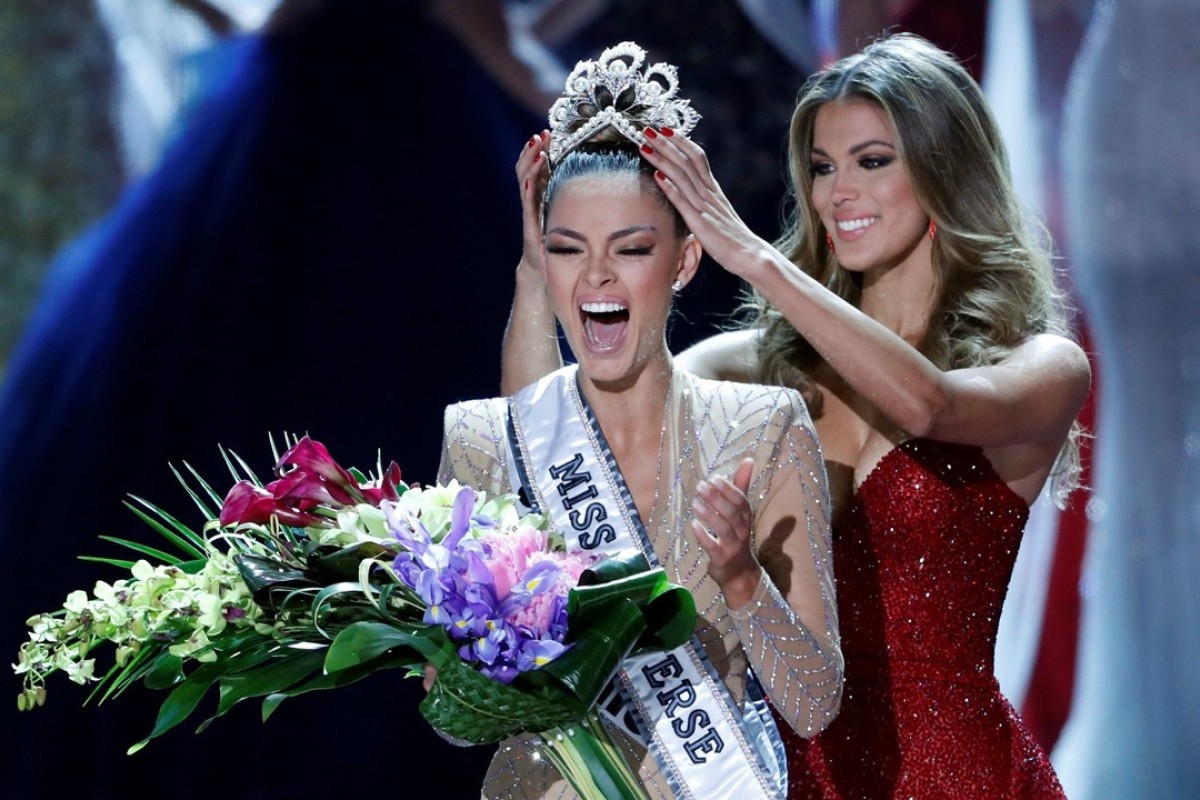 Miss South Africa Demi-Leigh Nel-Peters reacts as she is crowned by Miss Universe 2016 Iris Mittenaere during the 66th Miss Universe pageant. Photo: REUTERS
