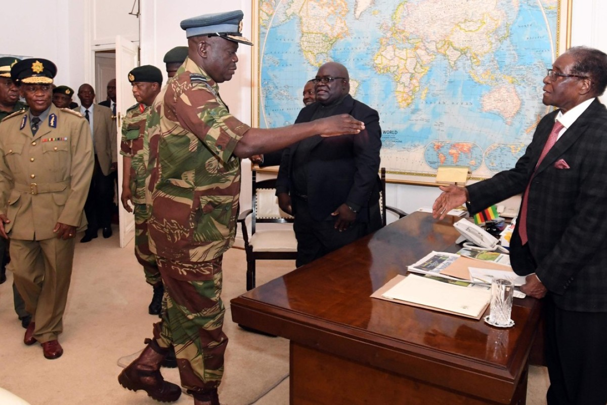 Zimbabwe's Robert Mugabe (right), in Harare, during a November 19 meeting with army chiefs who have seized power. Picture: AFP