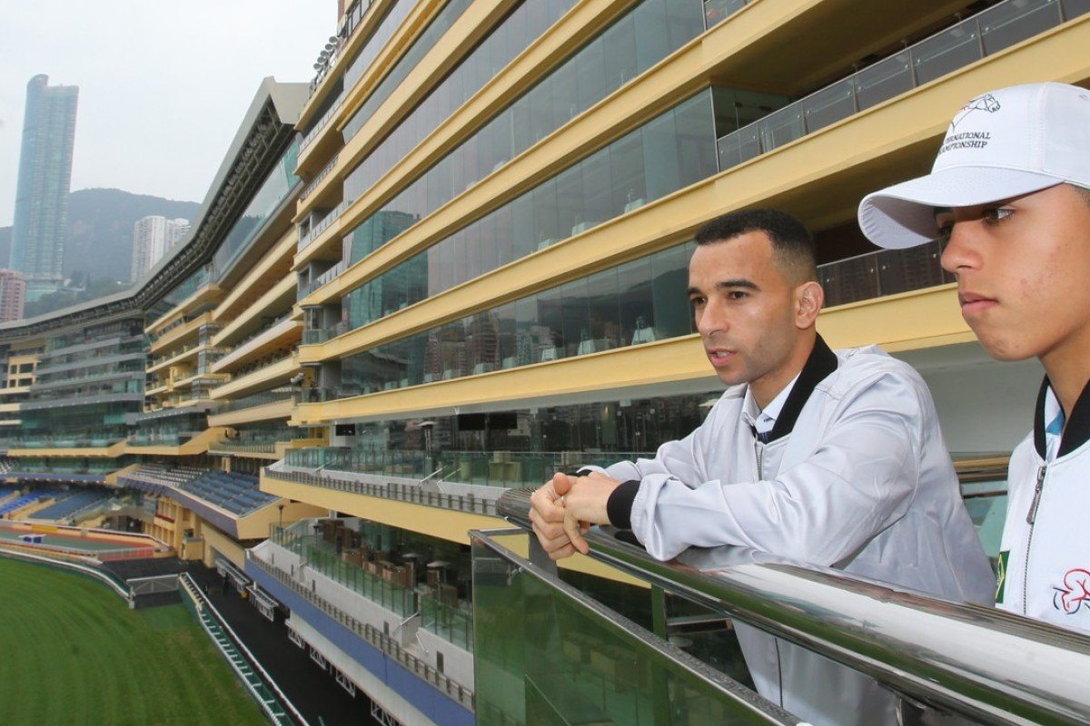 Joao Moreira (left) and Leandro Henrique look over the track at Happy Valley. Photos: Kenneth Chan