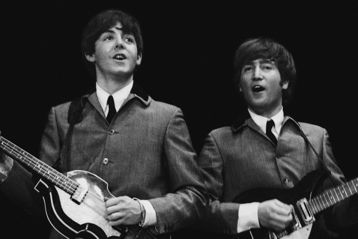 John Lennon (right) performs with Pail McCartney during the Beatles' first US concert, on February 11, 1964. Picture: AP