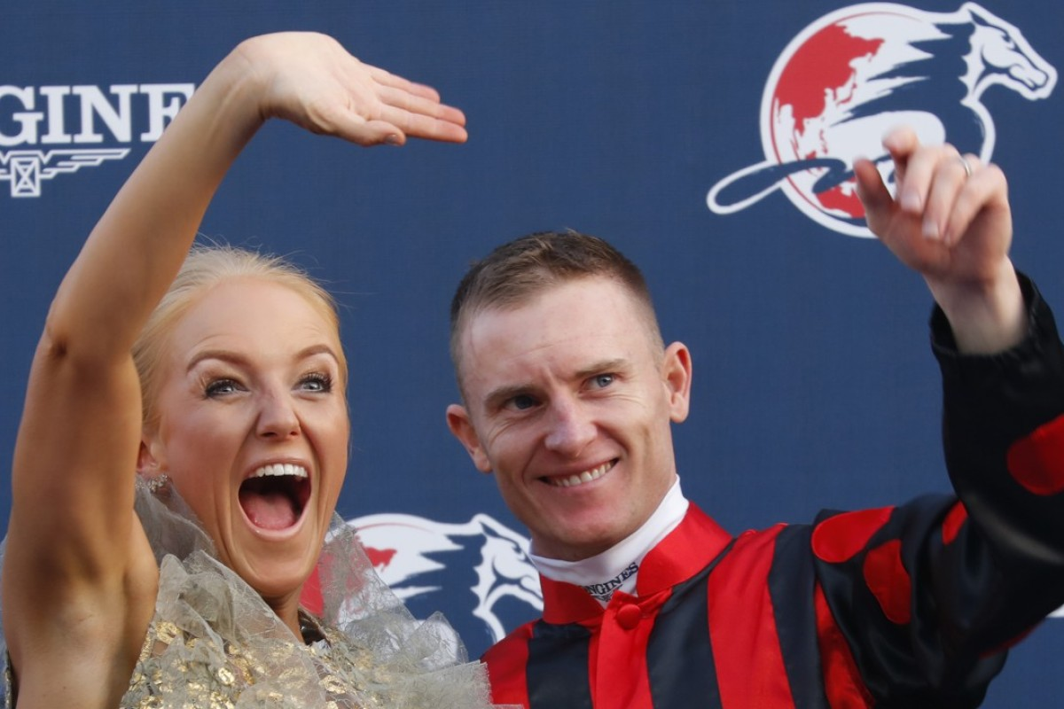 Zac Purton and wife Nicole celebrate after Time Warp's victory in the Hong Kong Cup. Photo: Kenneth Chan