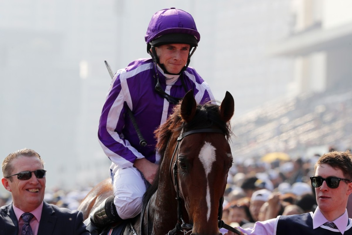 Ryan Moore and Highland Reel after winning the Hong Kong Vase. Photo: Kenneth Chan