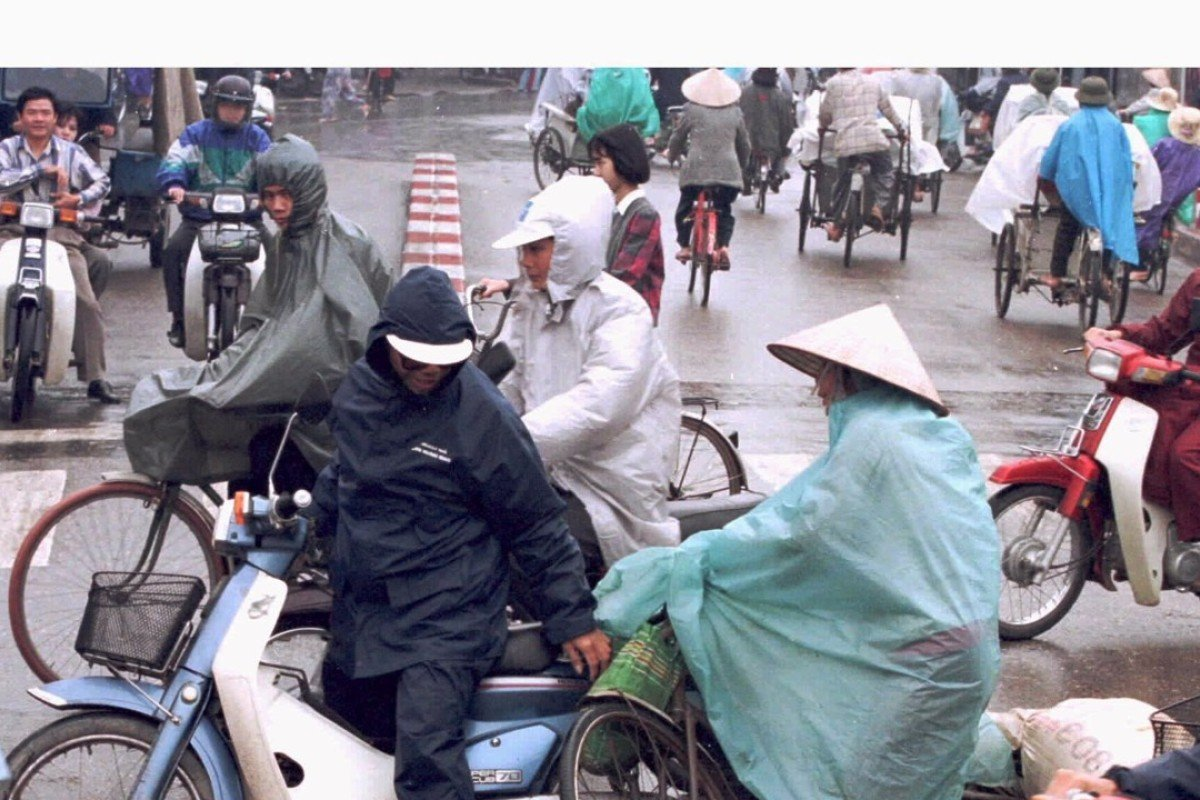 A cyclist skids into a motorbike at a busy intersection in central Hanoi. Vietnam claims that its actions to prevent traffic accidents in increasingly chaotic cities has begun to pay off, with the number of fatalities dropping sharply. Photo: Reuters