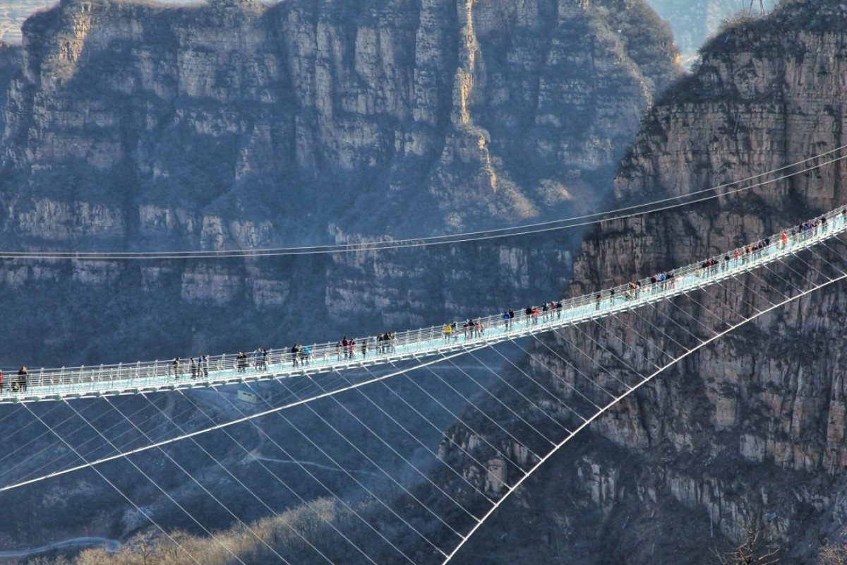 The glass suspension bridge at Hongyagu Scenic Area in Pingshan county, Hebei province. Photo: Xinhua