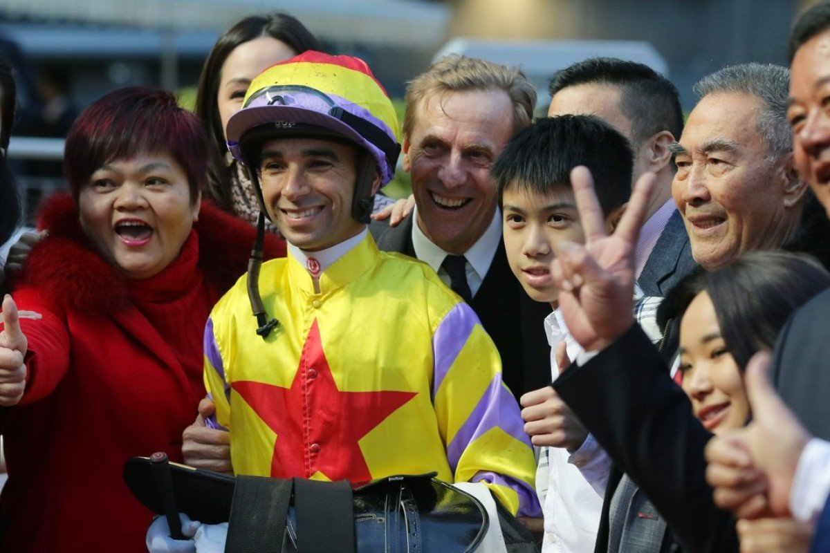 Joao Moreira and John Size smile for photos with the connections of Ping Hai Star. Photos: Kenneth Chan