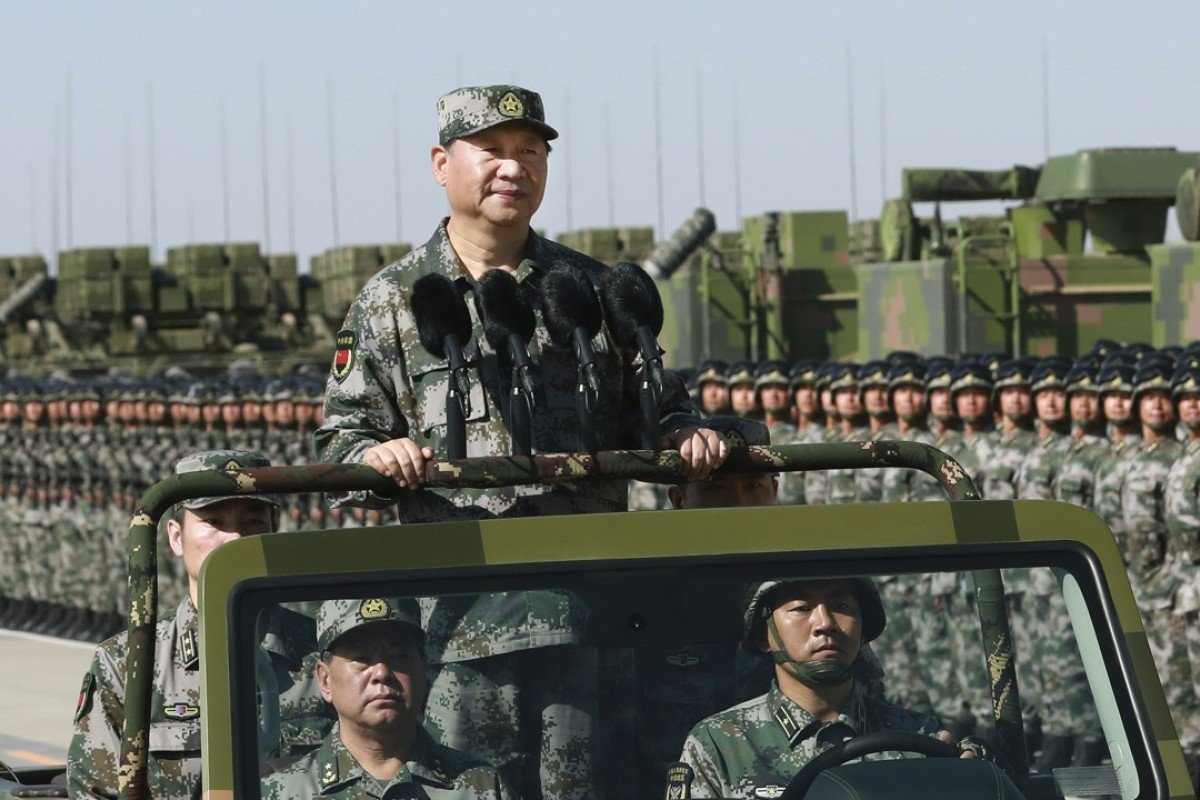 President Xi Jinping inspects troops of the People's Liberation Army during a military parade to commemorate the 90th anniversary of the founding of the PLA at Zhurihe training base in north China. Photo: Li Gang