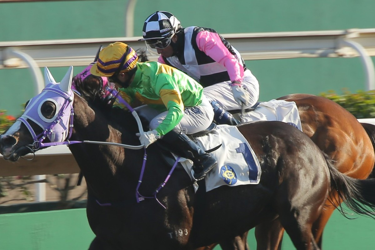 Keith Yeung drives Classic Emperor to victory at Sha Tin on Saturday. Photos: Kenneth Chan