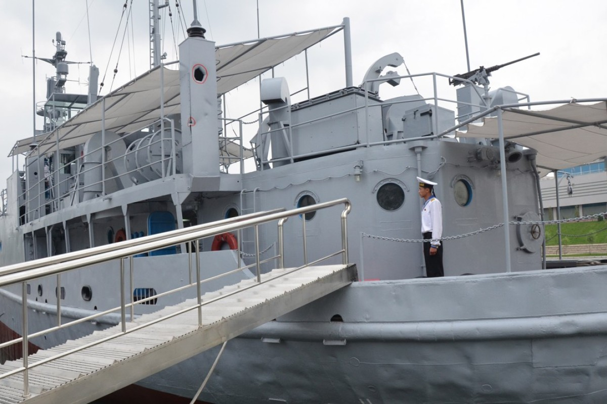 A North Korean seaman aboard the USS Pueblo, a US Navy ship captured by North Korea in 1968 and now moored in Pyongyang and serving as a museum and symbol of North Korean military might. Picture: AFP