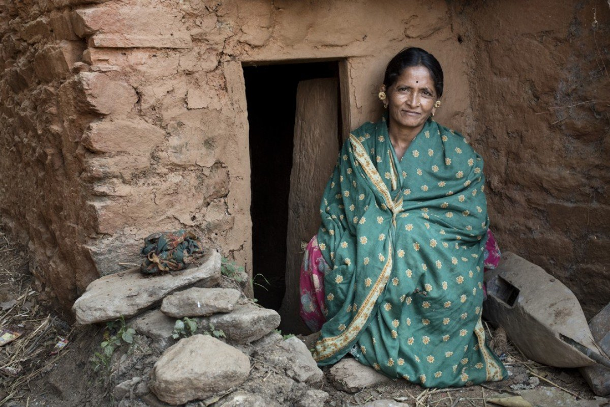 Ganga Kunwar in front of her hut, or goth, in Payal, Achham. Pictures: Miguel Candela