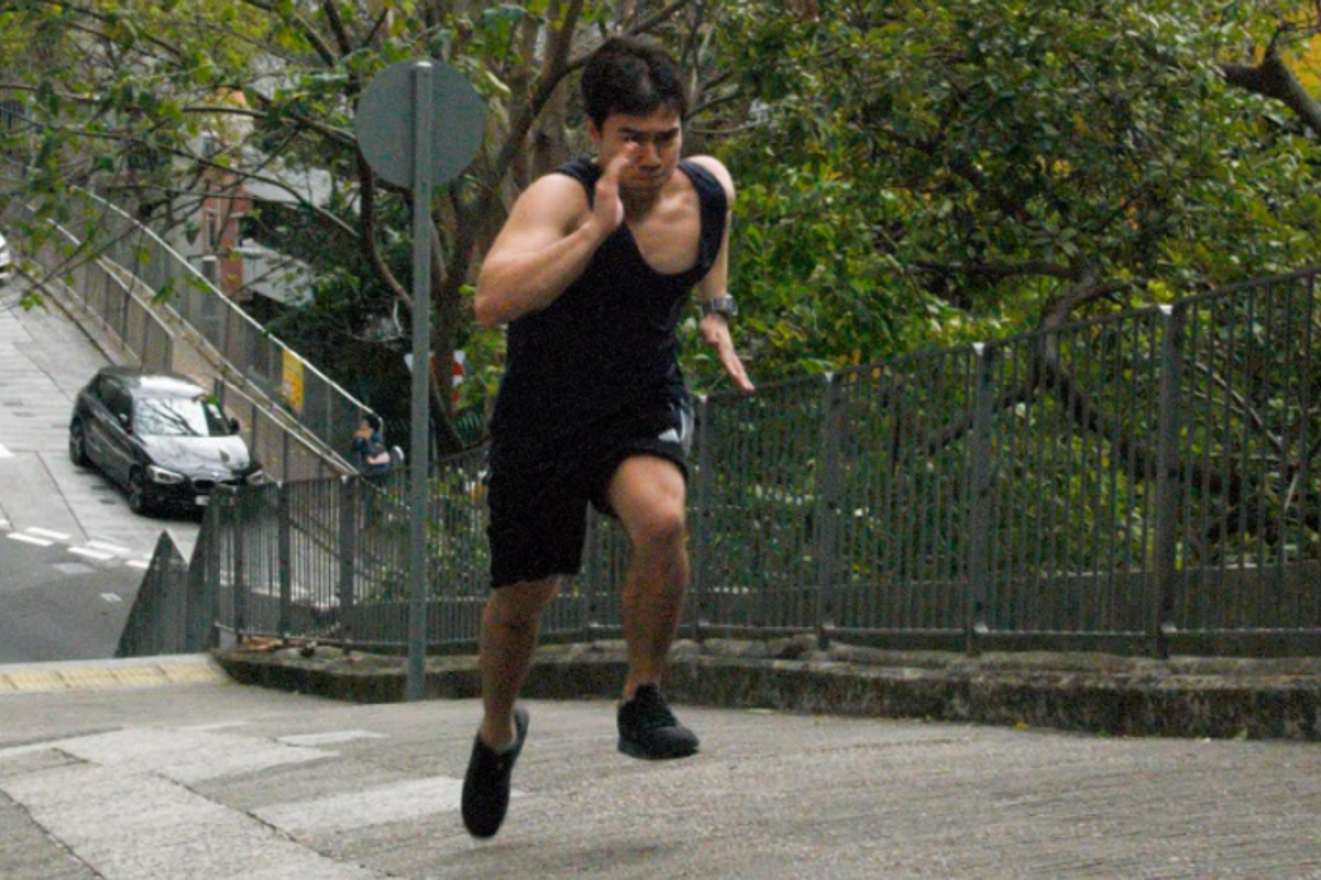 Young Post reporter Ben Young sprints up Wan Chai Gap Road in preparation for the Spartan Race. Photo: Mark Agnew