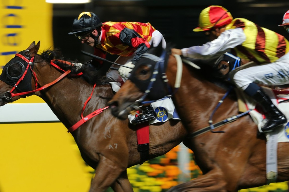 Olivier Doleuze drives Bond Elegance to victory at Happy Valley on Wednesday night. Photo: Kenneth Chan