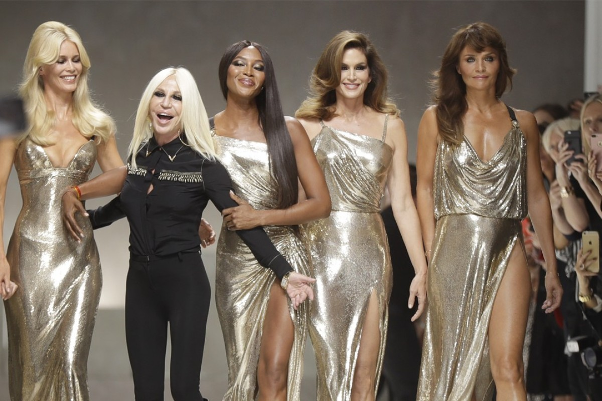 Claudia Schiffer, Donatella Versace, Naomi Campbell, Cindy Crawford and Helena Christensen on the catwalk at the end of the Versace women's spring/summer 2018 fashion collection presented in Milan, Italy, in 2017. Versace has become the latest fashion house to eliminate fur from its collections, joining Gucci, Giorgio Arman, Hugo Boss among others. Photo: AP