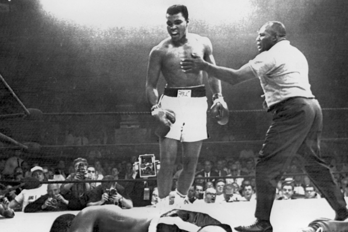"""Muhammad Ali (centre) knocks out challenger Charles """"Sonny"""" Liston in 1965. Picture: AFP"""