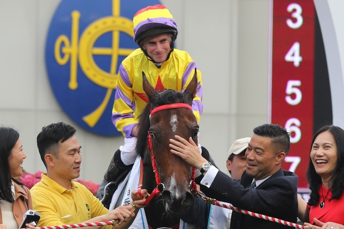 Ping Hai Star gets a pat from connections after winning the BMW Hong Kong Derby. Photos: Kenneth Chan