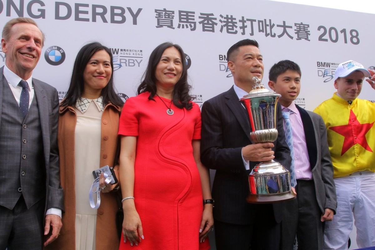 John Size (left) poses with connections of Hong Kong Derby winner Ping Hai Star. Photos: Kenneth Chan