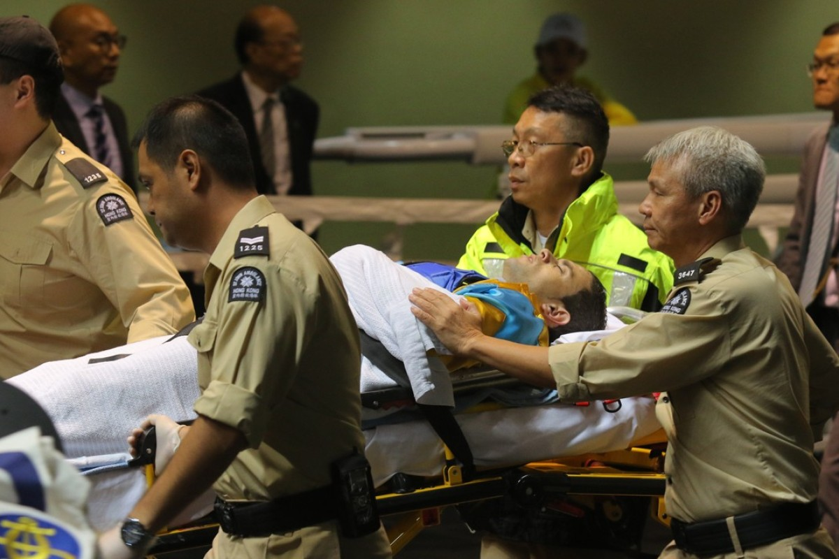 Umberto Rispoli is taken to hospital after a fall at Happy Valley in November 2016. Photos: Kenneth Chan.