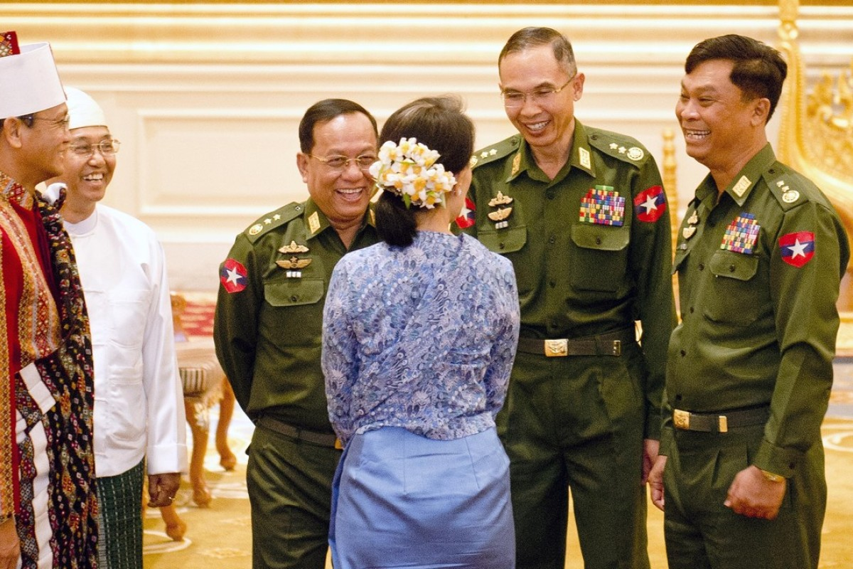 Aung San Suu Kyi with some of Myanmar's generals. Photo: AFP PHOTO