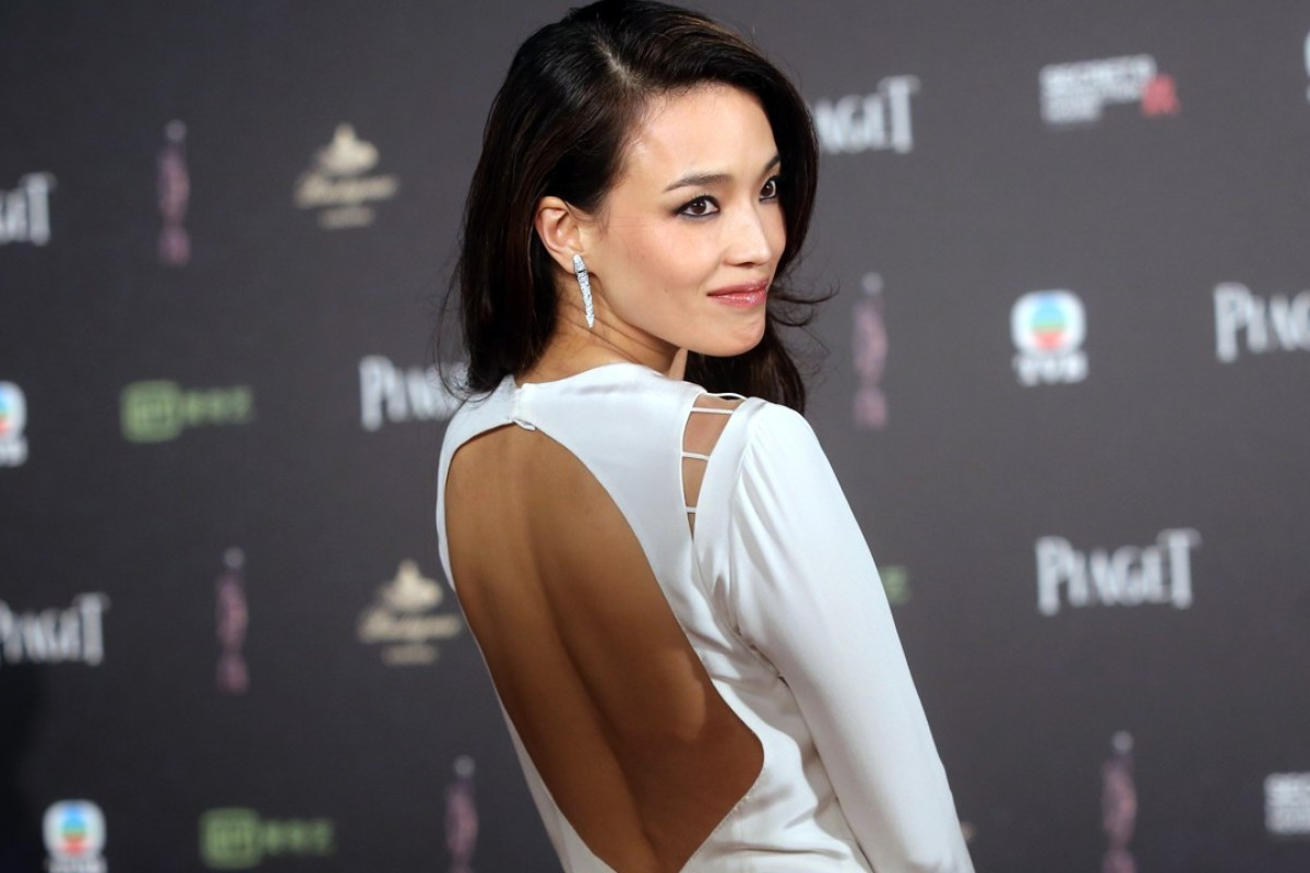 Taiwanese actress Shu Qi poses for the cameras on the red carpet at the 34th Hong Kong Film Awards.