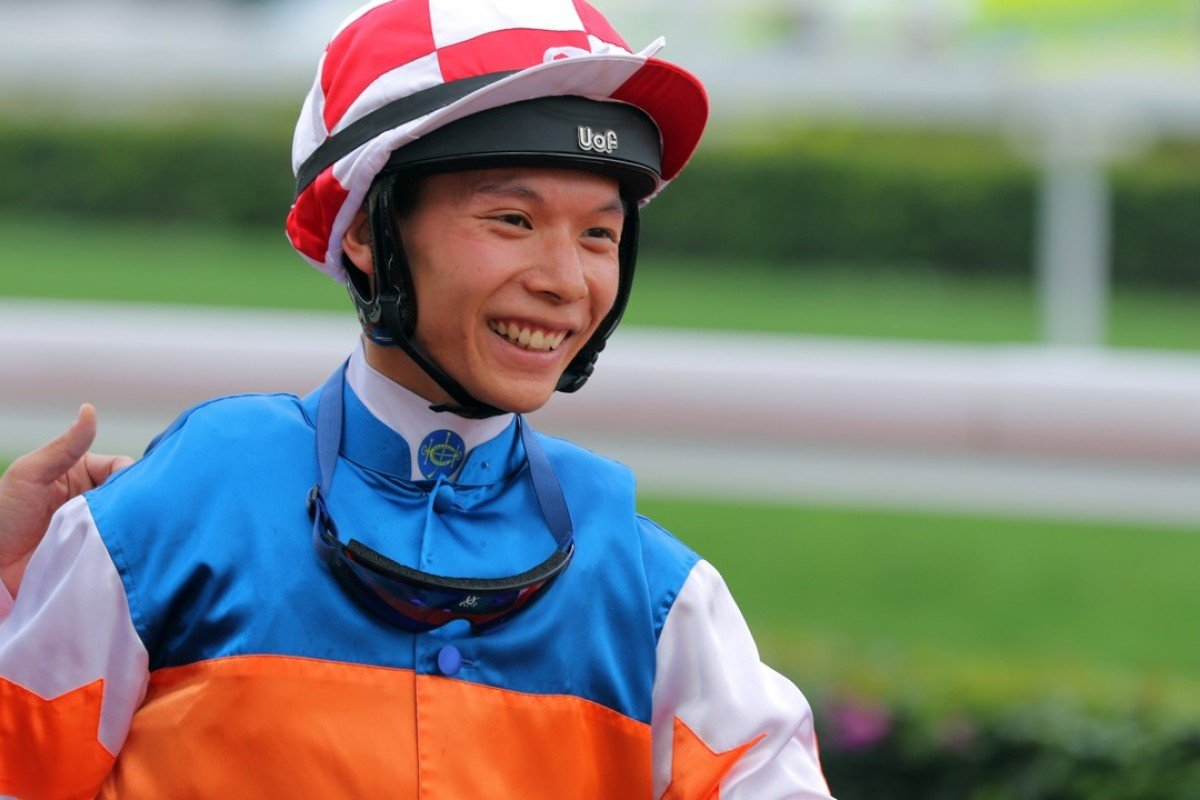 Victor Wong all smiles after winning aboard Nice Fandango. Photo: Kenneth Chan