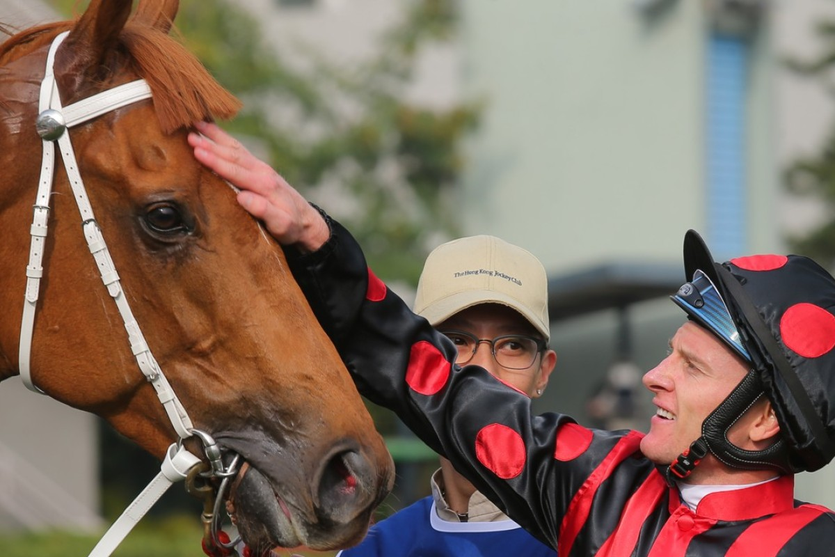 Zac Purton gives Time Warp a pat after their victory in the Citi Hong Kong Gold Cup at Sha Tin on February 18. Photos: Kenneth Chan