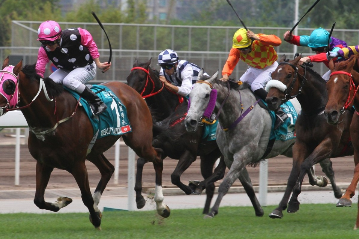 Zac Purton lifts Beauty Generation to victory in the Champions Mile. Photos: Kenneth Chan