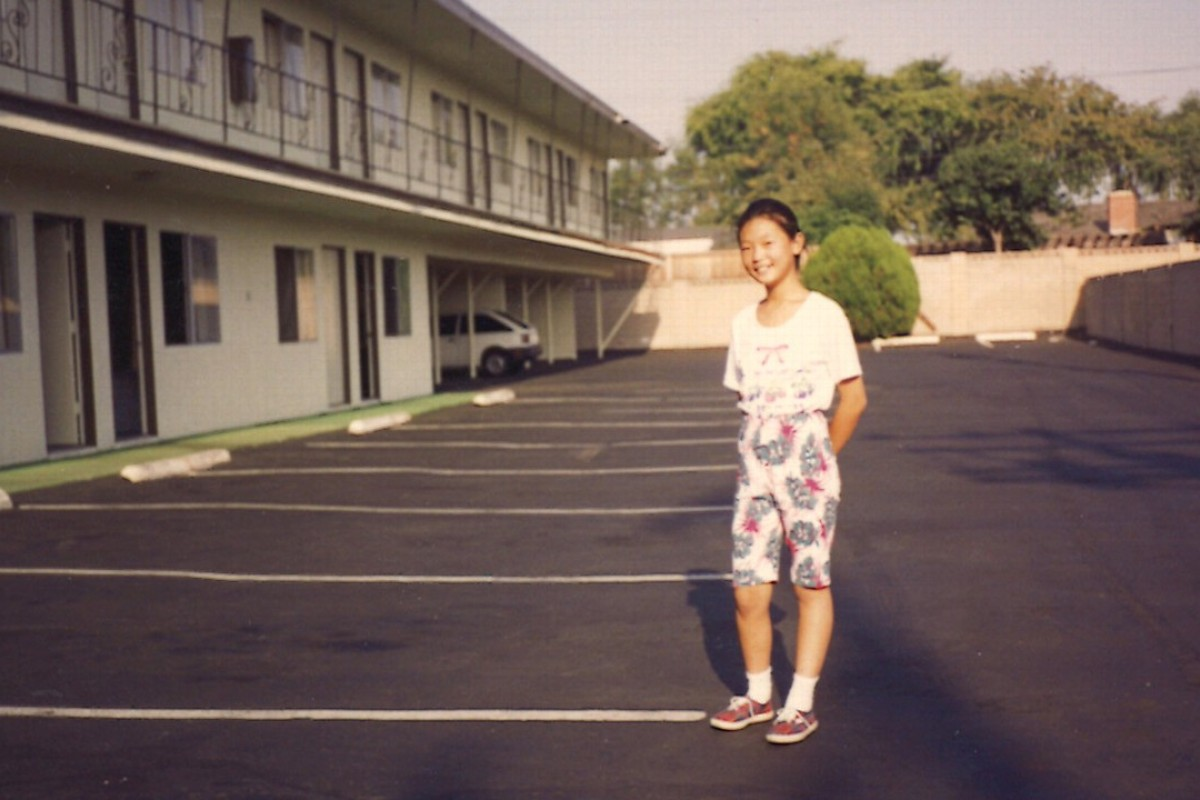 A young Kelly Yang outside the motel her parents managed in the US.