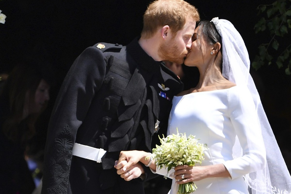 Britain's Prince Harry (left) and his wife Meghan Markle – wearing a Givenchy wedding dress created by its British artistic director Clare Waight Keller – kiss after their wedding ceremony at St George's Chapel in Windsor Castle, England, on Saturday. Photo: AP