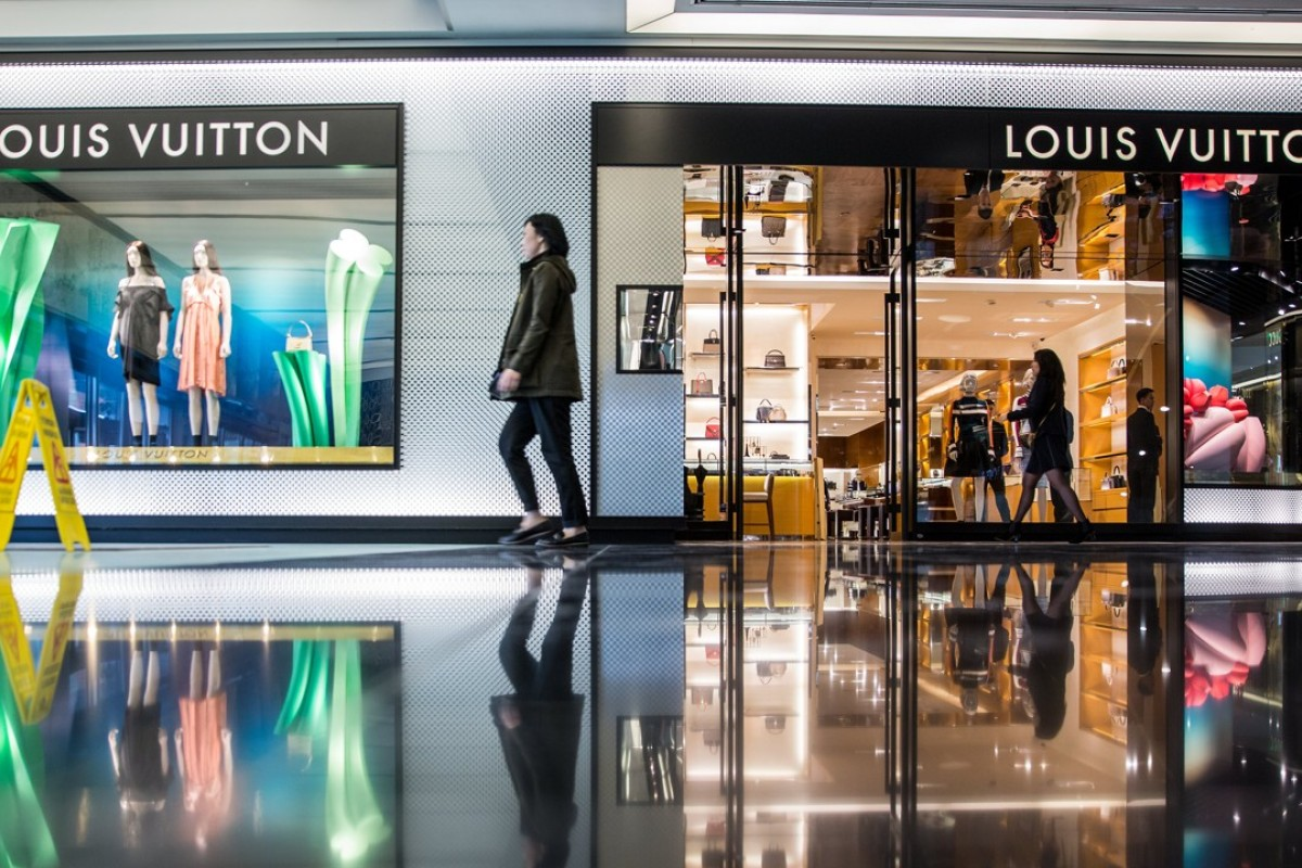 A shopper walks past a LVMH Moet Hennessy Louis Vuitton SE store at the Esentai Mall in Almaty, Kazakhstan. Louis Vuitton owner LVMH has just invested heavily in online fashion search business Lyst. Photo: Bloomberg