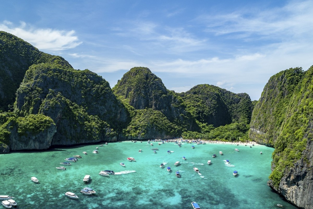 Boats crowd Maya Bay, on the island of Phi Phi Leh, in Thailand. Picture: Singha Estates
